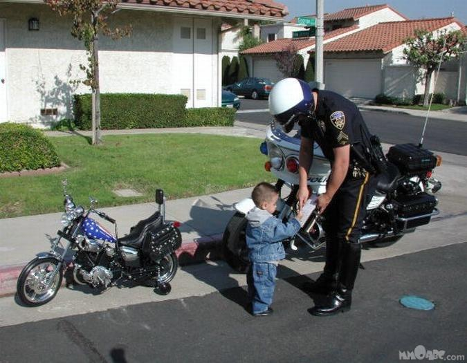 motorcycle_kid_gets_his_first_ticket