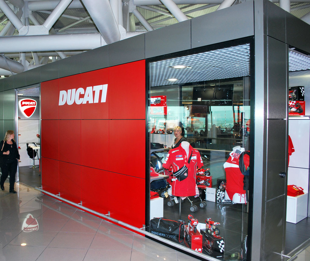 ducati opens first airport retail store news. Black Bedroom Furniture Sets. Home Design Ideas