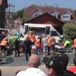 Emergency crews rush to the scene of a crash near the start of today's Isle of Man Senior TT race. Eleven spectators are reported injured. (Photo: Energy FM via SKY News)