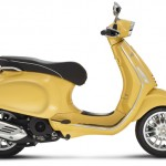 Vespa Sprint 125 yellow studio right profile