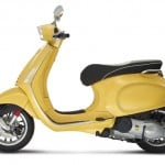 Vespa Sprint 125 yellow studio left profile