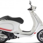 Vespa Sprint 125 white accessorized studio right profile