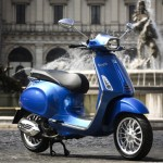 Vespa Sprint 125 blue outdoor right profile