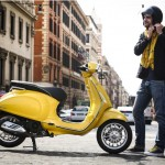 Vespa Sprint 125 yellow outdoor right profile