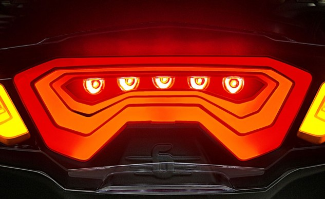 OLEDs alone are not bright enough to use as brake lights. Adding LEDs provides the required brightness while introducing interesting design concepts.