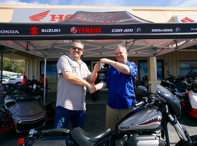 Earl Evans is presented with the keys to a custom Star Motorcycles Bolt R-Spec,  courtesy of Brian Fitzpatrick at Central Florida Powersports.