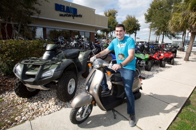 Gregory Hatfield gets ready to ride off from Deland Motorsports on his new KYMCO Campagno 110 scooter.