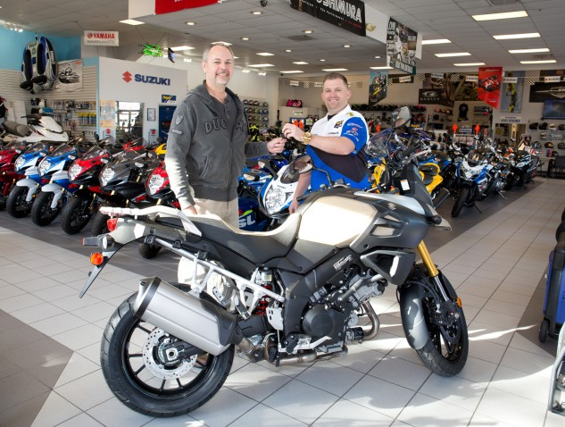 Kenneth Maves takes the keys to an all-new Suzuki V-Strom 1000 ABS Adventure motorcycle at Deland Motorsports, presented by Robert Stacey.