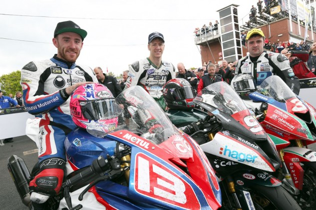 Lee Johnston (left) eat James Hillier at the finish line to take third place behind race winner Ian Hutchinson (center) and Michael Dunlop (right).