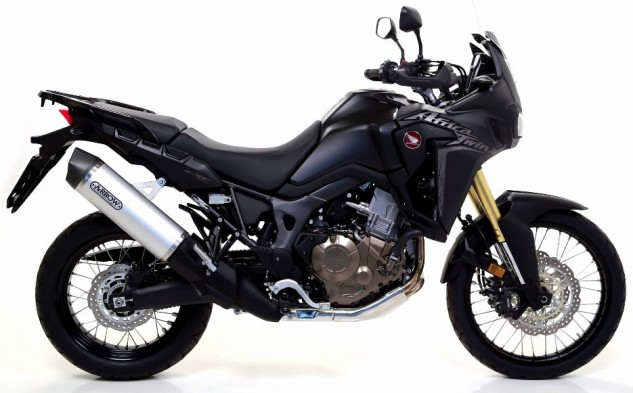 """Pictured is the Arrow Maxi Race-Tech Aluminum silencer, utilized to manage the power of this big pulse twin. The Arrow Maxi Race-Tech exhaust for the 2016 Africa Twin are also available in """"Dark """"Aluminum and Titanium."""