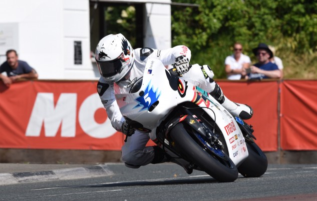 Bruce Anstey rounds a corner at Quaterbridge. Photo by Dave Kneale