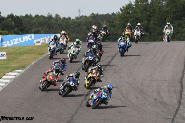 Toni Elias (24) leads Cameron Beaubier (1), Superstock 1000 winner Josh Herrin (2), Claudio Corti (71) and the rest of the Superbike field.
