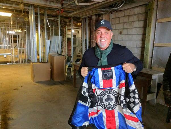 Piano man Billy Joel shows off the lining of his own Ace Cafe Hammersmith jacket last Friday during a private tour of the Ace ahead of his performance in Orlando. An avid motorcyclist, Joel loaned his Royal Enfield to the Ace, currently under construction - and on track for a spring 2017 opening - in downtown Orlando.